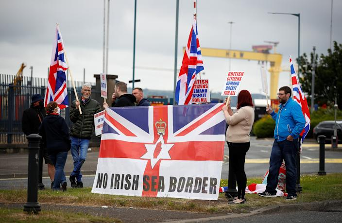 Loyalists protest against the Northern Ireland Brexit protocol at Belfast Harbour Estate (Reuters)
