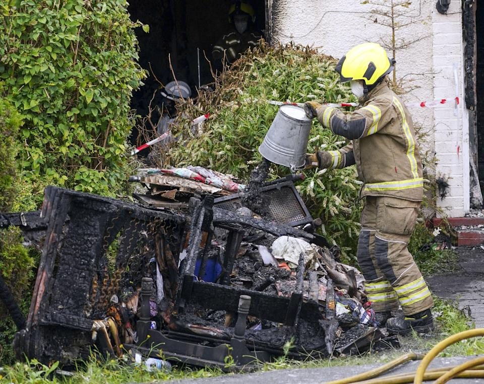 Firefighters worked to clear debris from the incident on Saturday (Steve Parsons/PA) (PA Wire)