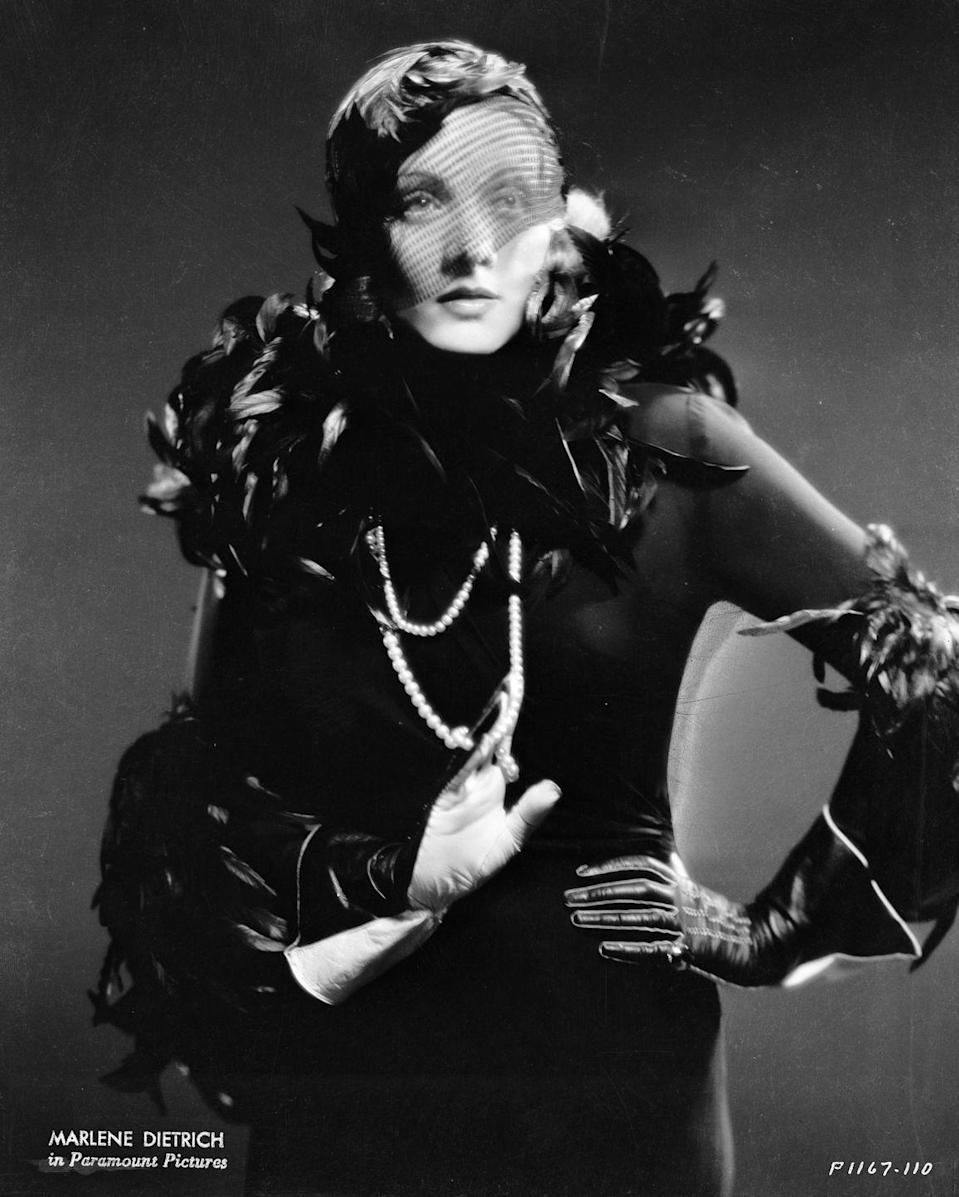 <p>Here, Dietrich poses as Madeline in the film <em>Shanghai</em> <em>Express</em>. The costumes - including this spectacular feathered dress - were created by Travis Banton. <br></p>
