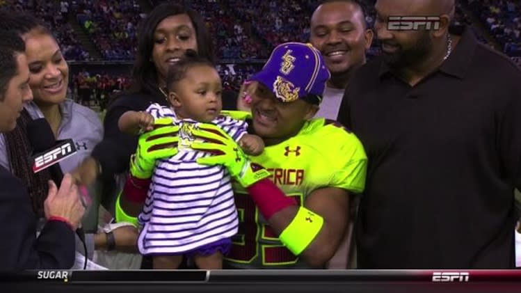 Jamal Adams announces his decision to play for LSU using his baby niece as a prop -- ESPN screen shot