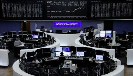 Traders work in front of the German share price index, DAX board, at the stock exchange in Frankfurt, Germany, July 3, 2017. REUTERS/Staff/Remote