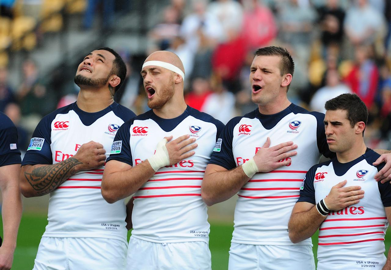 KENNESAW, GA - MARCH 29: Samu Manoa #5, Scott Lavalla #7, Cameron Dolan #8, and Mike Petri #9 of the USA Eagles sing during the national anthem before the opening qualifying match of the 2015 IRB Rugby World Cup against Uruguay at Fifth Third Bank Stadium on March 29, 2014 in Kennesaw, Georgia. (Photo by Scott Cunningham/Getty Images)