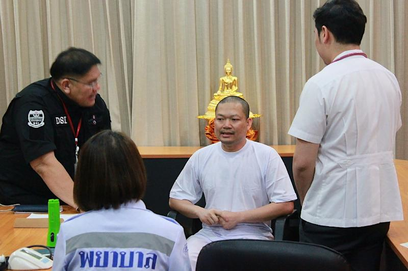 Disgraced ex-Buddhist monk Wiraphon Sukphon speaks to officials in Bangkok, on July 20, 2017
