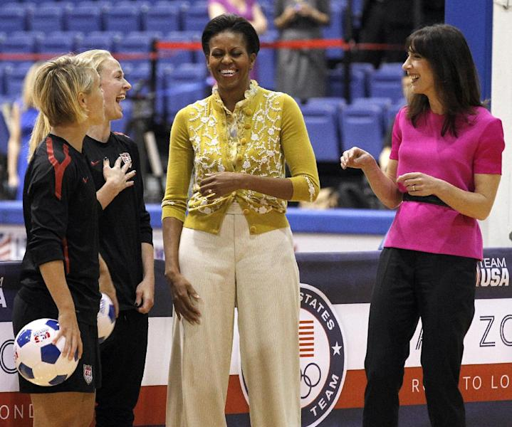First lady Michelle Obama and Samantha Cameron, wife of British Primer Minister David Cameron, talk with United States Women's National Soccer Team midfielder Lori Ann Lindsey, left, and defender Becky Sauerbrunn as they join with students participating in a mini-Olympics competition in celebration of the 2012 London Summer Olympics and Mrs. Obama's Let's Move! initiative, Tuesday, March 13, 2012 in Washington. (AP Photo/Haraz N. Ghanbari)