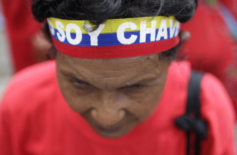 """A supporter of Venezuela's President Hugo Chavez wears a headband that reads in Spanish """"I am Chavez"""" during a small gathering of supporters near the military hospital in Caracas, Venezuela, Tuesday, Feb. 26, 2013. The government said last week that the country's ailing president was continuing unspecified medical treatments at the military hospital in Caracas. Chavez's sudden return to Venezuela after more than two months of cancer treatments in Cuba has fanned speculation that the president could be preparing to relinquish power and make way for a successor and a new election. (AP Photo/Ariana Cubillos)"""