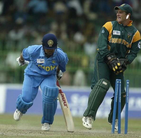 COLOMBO - SEPTEMBER 25:  Mark Boucher of South Africa runs out Sachin Tendulkar of India during the ICC Champions Trophy semi final match between India and South Africa at the Premadasa Stadium in Colombo, Sri Lanka  on September 25, 2002. (Photo by Clive Mason/Getty Images.)