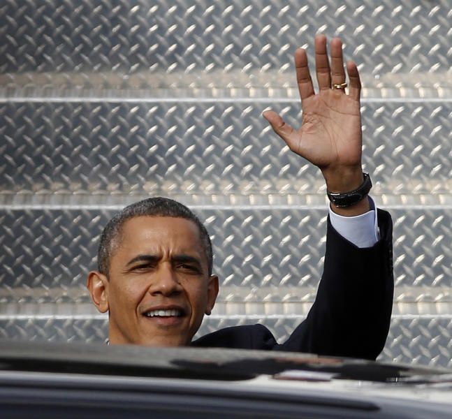 President Barack Obama waves upon his arrival at the Lima Allen County Airport, Friday, Nov. 2, 2012, in Lima, Ohio, prior to a campaign stop. (AP Photo/David Kohl)