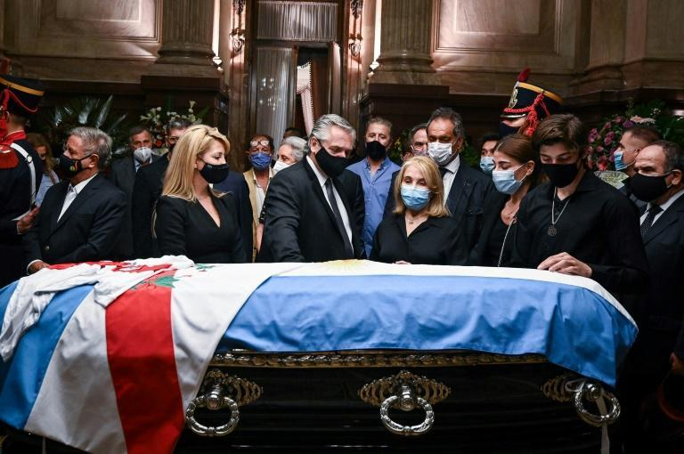 President Alberto Fernandez (C) and his wife Fabiola Yanez (L) stand by Carlos Menem's coffin with the late former president's daughter Zulema Menem (2R), her mother Zulema Yoma (2R) and her son Luca Bertoldi Menem (R) in the Argentine Senate