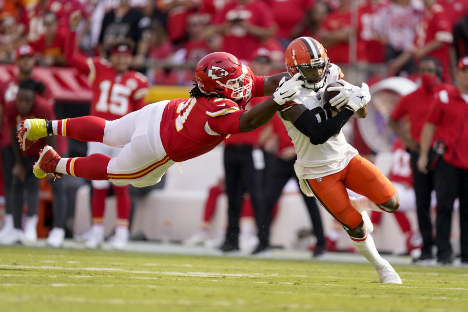 Cleveland Browns wide receiver Jarvis Landry, right, runs with the ball as Kansas City Chiefs defensive tackle Derrick Nnadi defends during the first half of an NFL football game Sunday, Sept. 12, 2021, in Kansas City, Mo. (AP Photo/Charlie Riedel)