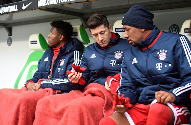 Soccer Football - Bundesliga - VfL Wolfsburg vs Bayern Munich - Volkswagen Arena, Wolfsburg, Germany - February 17, 2018 Bayern Munich's Robert Lewandowski, Jerome Boateng and David Alaba sat on the bench before the match REUTERS/Fabian Bimmer DFL RULES TO LIMIT THE ONLINE USAGE DURING MATCH TIME TO 15 PICTURES PER GAME. IMAGE SEQUENCES TO SIMULATE VIDEO IS NOT ALLOWED AT ANY TIME. FOR FURTHER QUERIES PLEASE CONTACT DFL DIRECTLY AT + 49 69 650050
