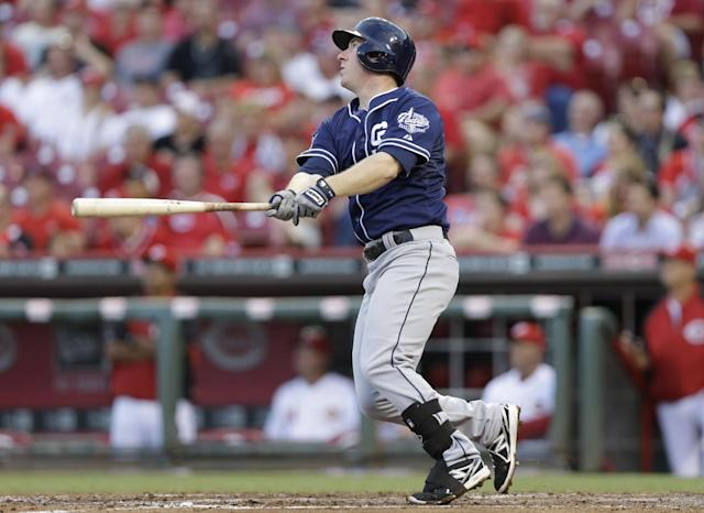 San Diego Padres' Jedd Gyorko watches his sacrifice fly off Cincinnati Reds starting pitcher Mike Leake that drove in a run in the fourth inning of a baseball game, Tuesday, May 13, 2014, in Cincinnati. (AP Photo)
