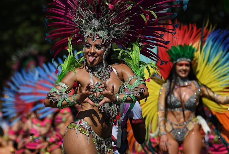 Performers take part in last year's Notting Hill Carnival: AFP/Getty
