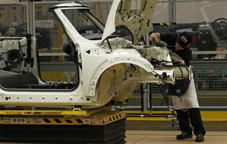 An employee works on a 2013 Mini at BMW's plant in Oxford, southern England