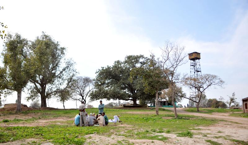 Border villagers play cards as they sit near a Indian post at Chandu Chak village of Ranbir Singh Pura sector near the India-Pakistan international border, about 35km from Jammu on February 28, 2019 in Jammu, India.