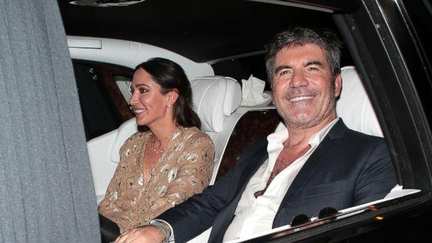 PHOTO: Lauren Silverman and Simon Cowell seen leaving Hammersmith Apollo after Britain's Got Talent - semi final day 3, May 30, 2018 in London, England. (Ricky Vigil/GC Images/Getty Images)