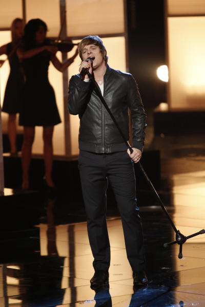 """This Monday, Dec. 17, 2012 file photo released by NBC shows Terry McDermott performing on """"The Voice,"""" """"Live Show"""" Episode 323A on the part one season 3 finale in Los Angeles. Three contestants, McDermott, Nicholas David and Cassadee Pope vie for the title in the NBC reality show. (AP Photo/NBC, Tyler Golden)"""