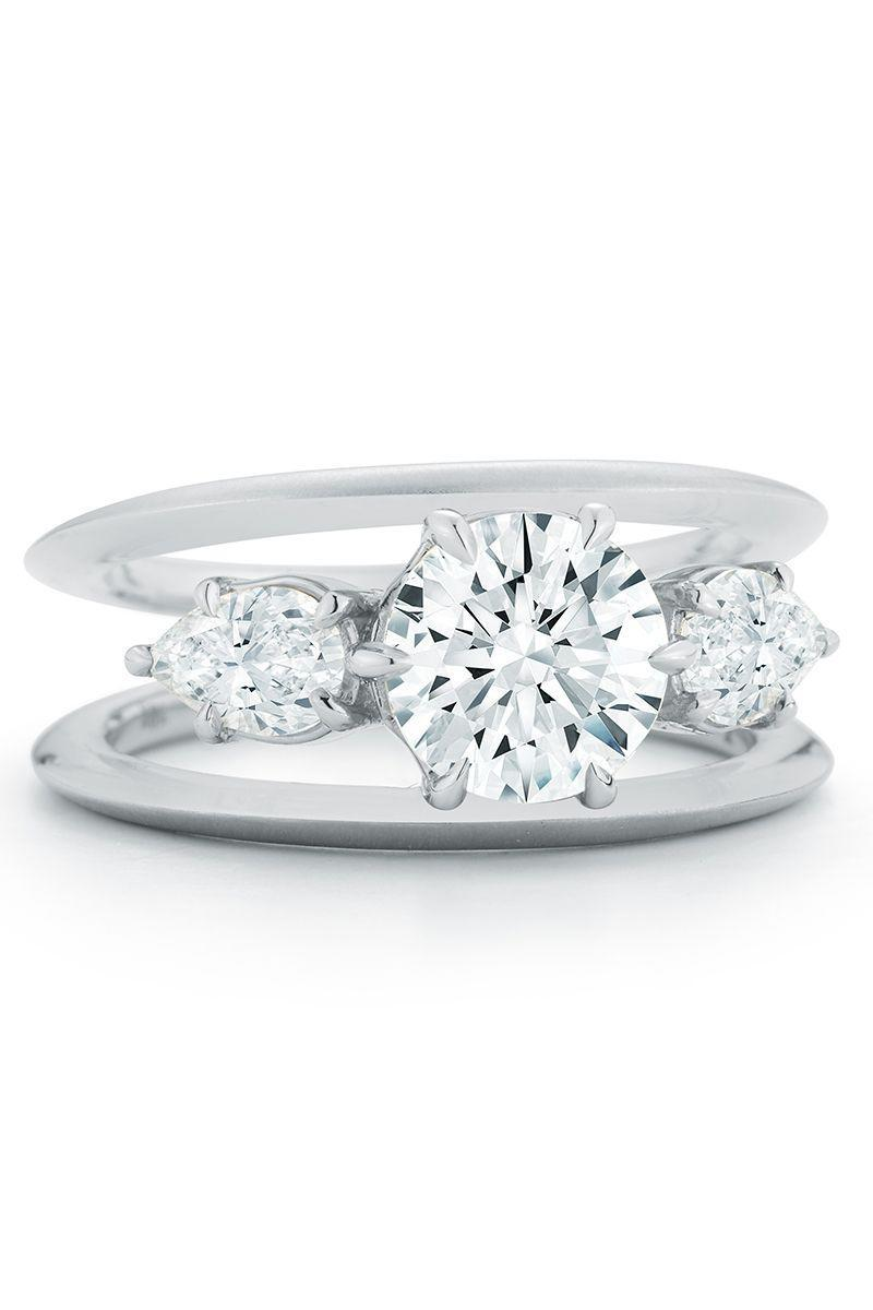 "<p>This floating diamond look gives the illusion of loads of sparkle floating on air. Previously used in more fashion and cocktail ring settings, this trend is hitting the engagement ring scene—and the cool factor is off the charts. From tiny spirals to sleek lines, these rings are unconventional and mesmerizing all at once.</p><p><em><strong>Jade Trau</strong> ""Sadie"" Three Stone Ring with a brilliant round center surrounded by two petite diamond petals in 18K gold, $30,000, <a href=""https://jadetrau.com/collections/rings/products/sadie-three-stone-ring-ready-to-ship"" rel=""nofollow noopener"" target=""_blank"" data-ylk=""slk:jadetrau.com"" class=""link rapid-noclick-resp"">jadetrau.com</a>.</em></p><p><a class=""link rapid-noclick-resp"" href=""https://jadetrau.com/collections/rings/products/sadie-three-stone-ring-ready-to-ship"" rel=""nofollow noopener"" target=""_blank"" data-ylk=""slk:SHOP"">SHOP</a><br><br></p>"