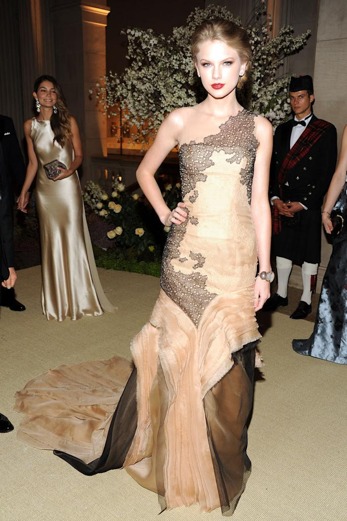 Taylor Swift attends the Metropolitan Museum of ArtÕs 2011 Costume Institute Gala featuring the opening of the exhibit Alexander McQueen: Savage Beauty. Swift wears J. Mendel.