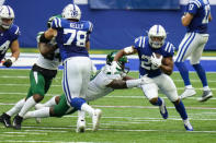 Indianapolis Colts running back Jonathan Taylor (28) breaks the tackle of New York Jets defensive tackle Foley Fatukasi (94) in the second half of an NFL football game in Indianapolis, Sunday, Sept. 27, 2020. (AP Photo/AJ Mast)
