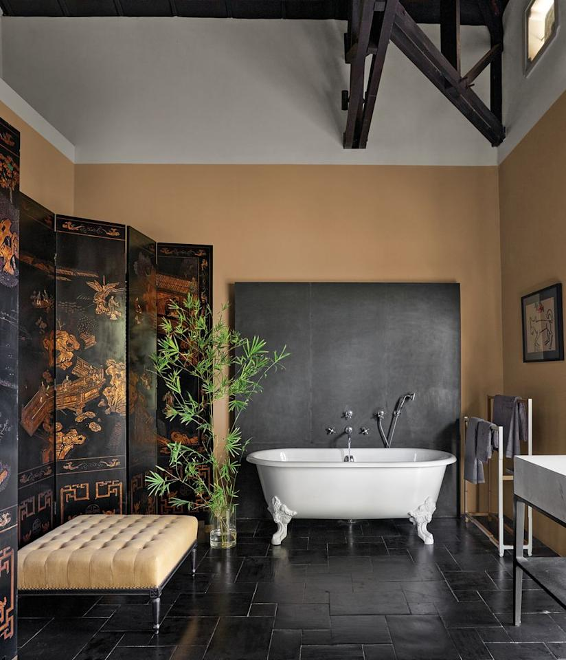 <p>Brown, like the almond paint shade featured in this master bath, is a nice alternative to the vibrant hues that are typical for the fall season. Use the warm color on walls or settle for a simple piece of brown-colored furniture, such as an ottoman, for your fall design scheme. </p>