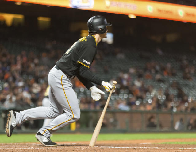 Pittsburgh Pirates' Bryan Reynolds hits a RBI single for the go-ahead run against the San Francisco Giants in the ninth inning of a baseball game in San Francisco, Monday, Sept. 9, 2019. (AP Photo/John Hefti)