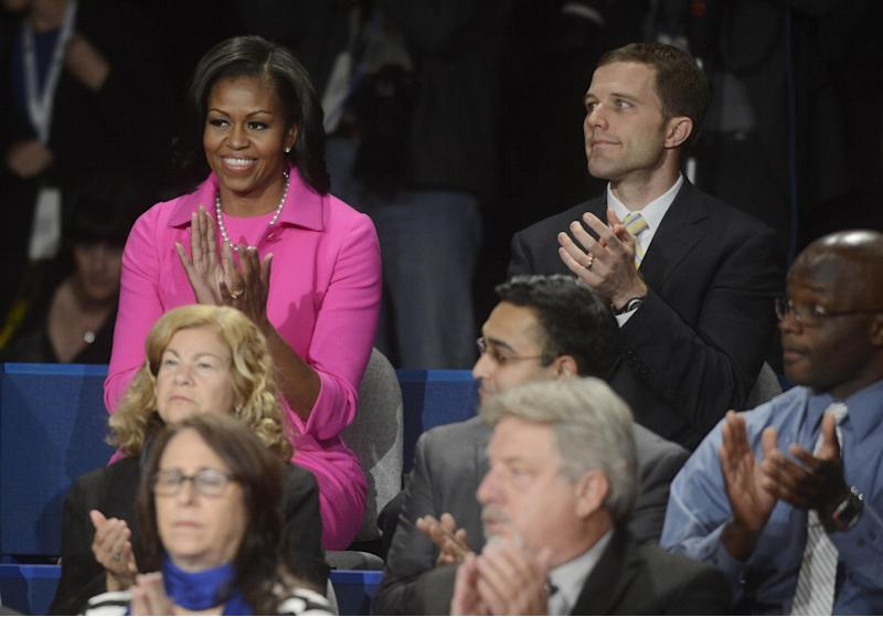 First lady Michelle Obama applauds before the start of the second presidential debate between President Barack Obama and Republican presidential nominee Mitt Romney at Hofstra University, Tuesday, Oct. 16, 2012, in Hempstead, N.Y. Seated right of Mrs. Obama is Seth Bodnar from Western Pennsylvania. (AP Photo/Pool-Michael Reynolds)