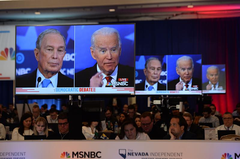 Democratic presidential hopefuls Former New York Mayor Mike Bloomberg (L) and Former Vice President Joe Biden (R) are seen on screens in a media room during the ninth Democratic primary debate of the 2020 presidential campaign season co-hosted by NBC News, MSNBC, Noticias Telemundo and The Nevada Independent at the Paris Theater in Las Vegas, Nevada, on February 19, 2020. (Photo by Bridget BENNETT / AFP) (Photo by BRIDGET BENNETT/AFP via Getty Images)