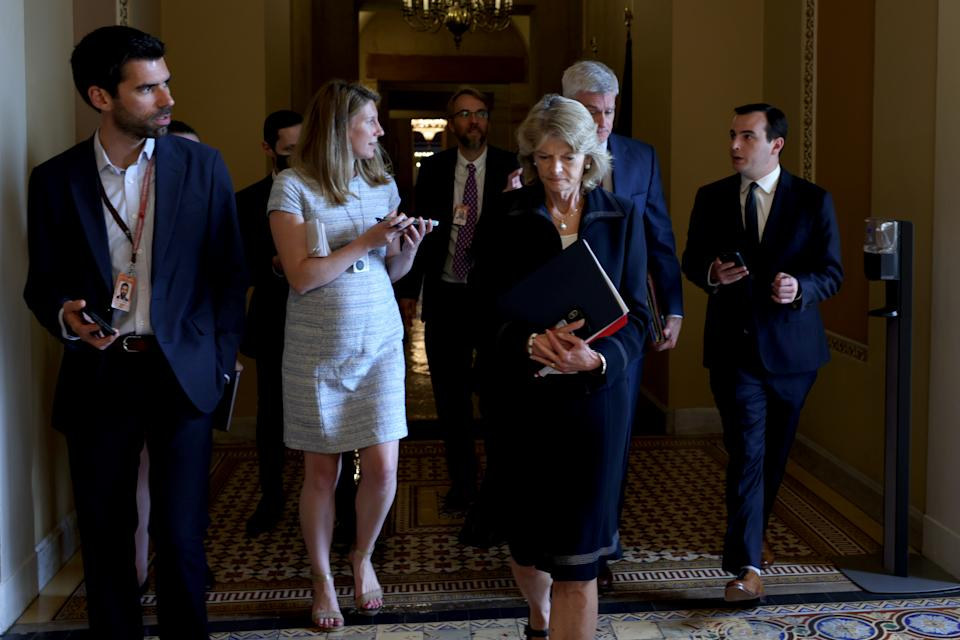 WASHINGTON, DC - JUNE 09: Sen. Lisa Murkowski (R-AK) (L) and Sen. Bill Cassidy (R-LA) (2nd R) leave the office of Senate Minority Leader Mitch McConnell (R-KY) following a meeting on Capitol Hill on June 09, 2021 in Washington, DC. Since the talks on infrastructure legislation with the White House fell through, a bipartisan group of senators have organized to try drafting a proposal themselves. (Photo by Anna Moneymaker/Getty Images)