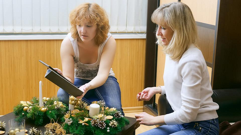 two women working on holiday decorations