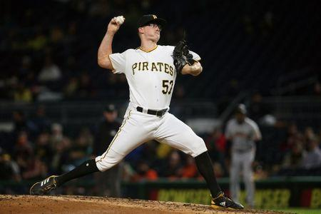 FILE PHOTO: Apr 19, 2019; Pittsburgh, PA, USA;  Pittsburgh Pirates relief pitcher Nick Burdi (57) pitches against the San Francisco Giants during the eighth inning at PNC Park. Pittsburgh won 4-1. Mandatory Credit: Charles LeClaire-USA TODAY Sports