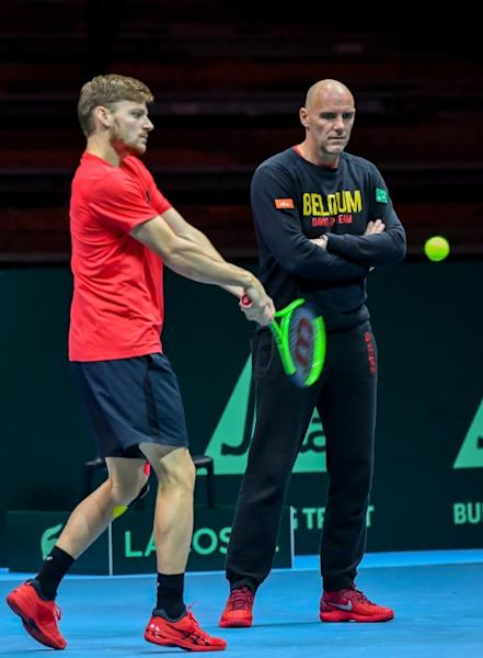 Belgium's captain Johan Van Herck (R) watches as David Goffin hits a return during a training session in Villeneuve d'Ascq on November 22, 2017, ahead of their Davis Cup World Group final against France