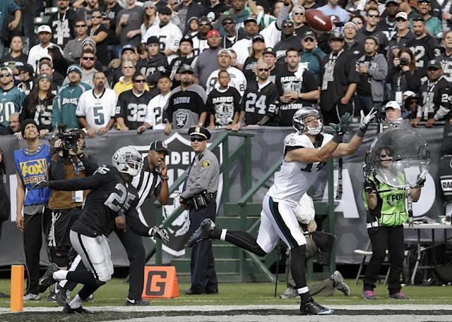 Philadelphia Eagles wide receiver Riley Cooper, right, catches a 17-yard touchdown pass against Oakland Raiders cornerback D.J. Hayden (25) during the second quarter of an NFL football game in Oakland, Calif., Sunday, Nov. 3, 2013. (AP Photo/Marcio Jose Sanchez)