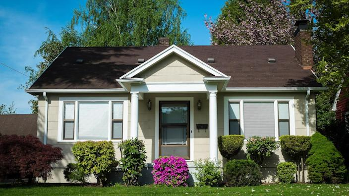 Single-family American craftsman house with blue sky background.