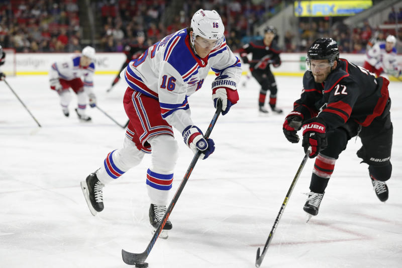 New York Rangers center Ryan Strome (16) tries to take a shot against Carolina Hurricanes defenseman Brett Pesce (22) during the first period of an NHL hockey game in Raleigh, N.C., Friday, Feb. 21, 2020. (AP Photo/Gerry Broome)