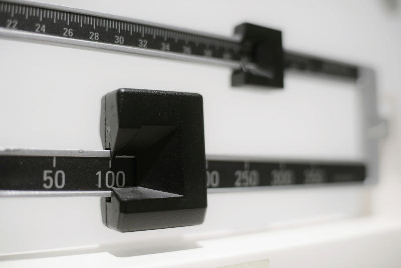 This Tuesday, April 3, 2018 photo shows a closeup of a beam scale in New York. New research released on Wednesday, April 4, 2018 suggests there's a critical window for overweight kids to get to a healthy level. Those who shed their extra pounds by age 13 had the same risk of developing diabetes in adulthood as others who had never weighed too much, a large study of Danish men found. (AP Photo/Patrick Sison)