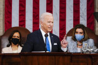FILE - In this April 28, 2021, file photo President Joe Biden addresses a joint session of Congress in the House Chamber at the U.S. Capitol in Washington, as Vice President Kamala Harris, left, and House Speaker Nancy Pelosi of Calif., look on. Biden has moved into a new phase of his presidency, having already begun to face a historic series of crises and largely dedicating his first 100 days to steady a nation reeling from the COVID-19 pandemic that has killed nearly 570,000 Americans and devastated its economy. (Melina Mara/The Washington Post via AP, Pool)
