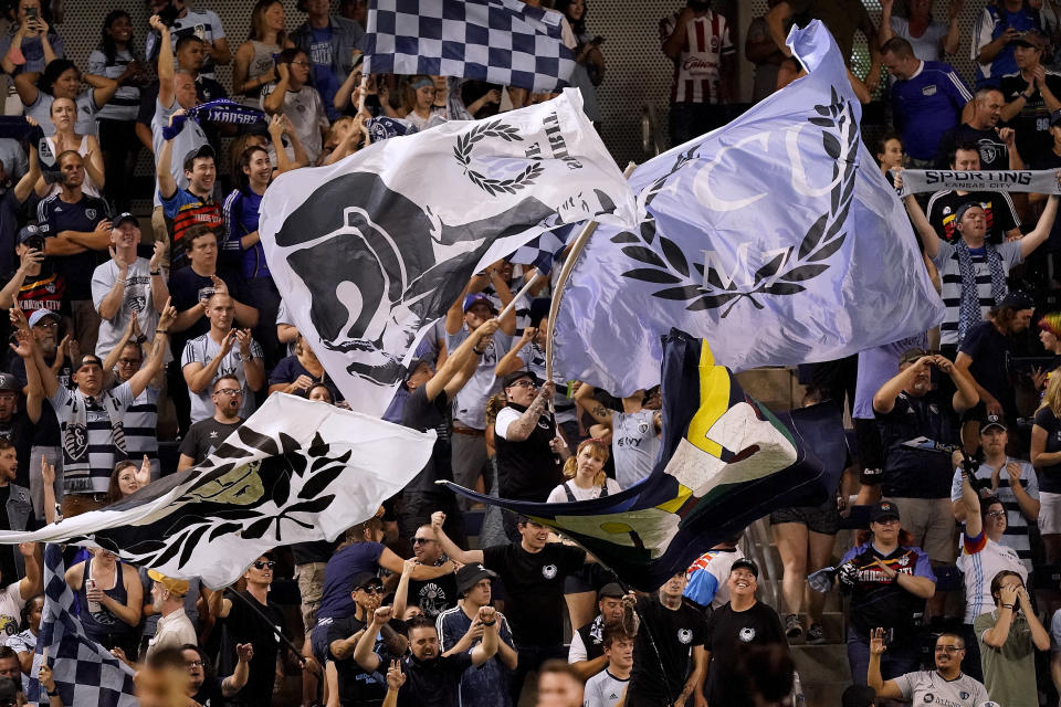 Sporting Kansas City fans celebrate after a goal during the first half of an MLS soccer match against the Colorado Rapids Saturday, Aug. 28, 2021, in Kansas City, Kan. (AP Photo/Charlie Riedel)