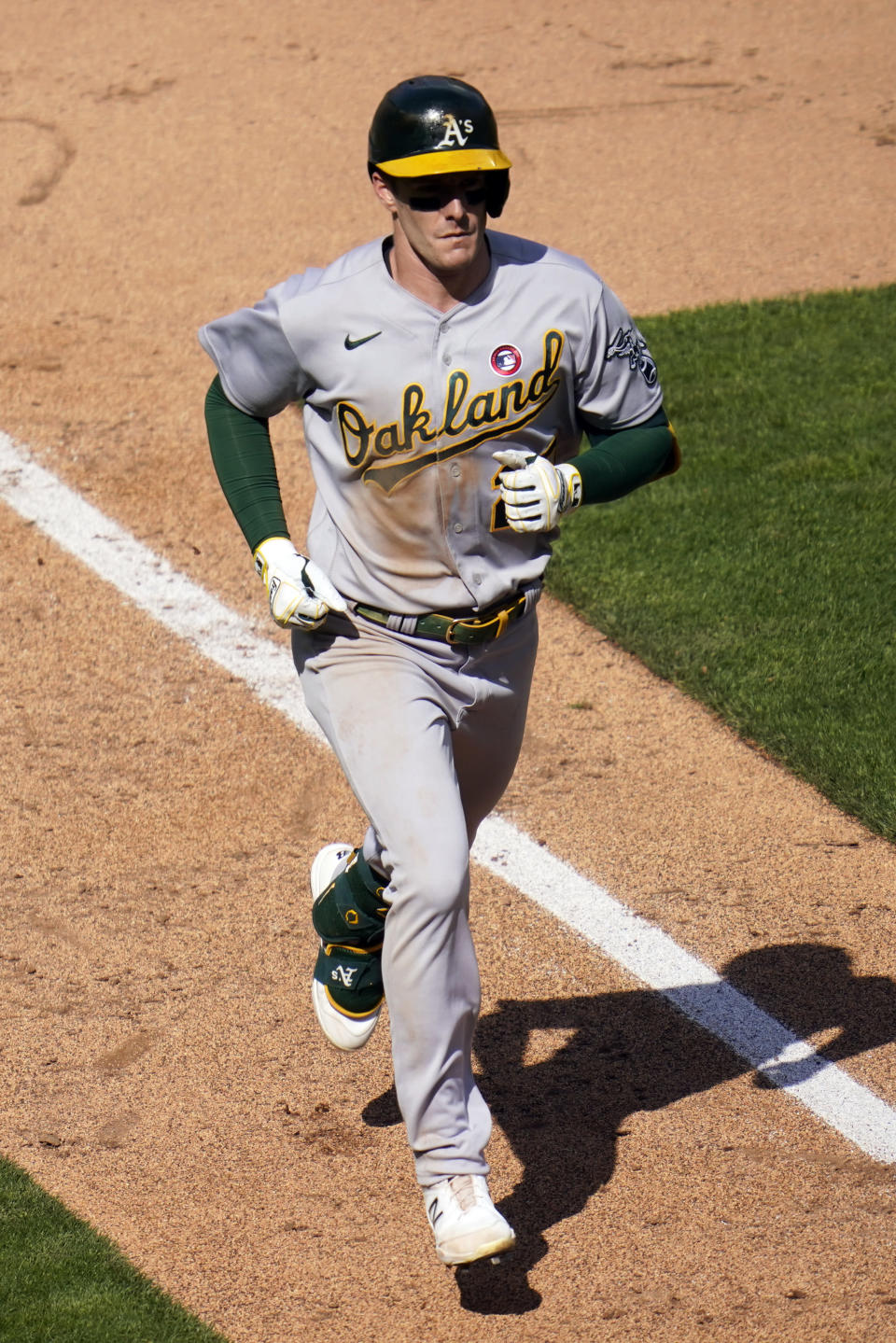 Oakland Athletics' Mark Canha (20) jogs home on a solo home run off Minnesota Twins pitcher Jose Berrios in the fifth inning of a baseball game, Saturday, May 15, 2021, in Minneapolis. (AP Photo/Jim Mone)