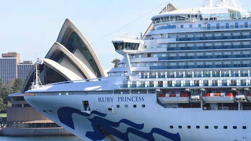 An empty Ruby Princess cruiseship heading past Sydney Opera House and out of Sydney Harbour on 19 March.
