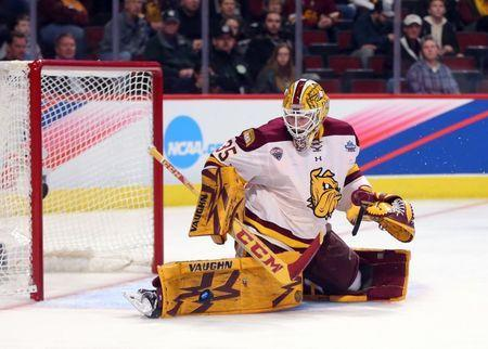 Apr 6, 2017; Chicago, IL, USA; Minnesota-Duluth Bulldogs goalie Hunter Miska (35) makes a save during the third period against the Harvard Crimson at United Center. Mandatory Credit: Dennis Wierzbicki-USA TODAY Sports