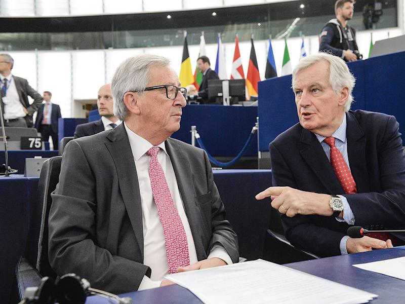 Michel Barnier (R) speaks with European Commission President Jean Claude Juncker at the European Parliament: Getty