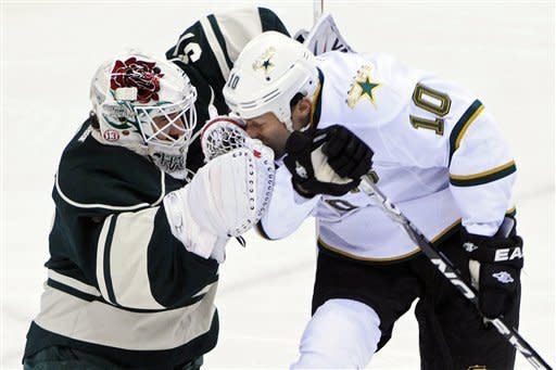 Dallas Stars' Brenden Morrow, right, collides with Minnesota Wild goalie Josh Harding in the first period of an NHL hockey game, Saturday, Jan. 21, 2012, in St. Paul, Minn. (AP Photo/ Jim Mone)