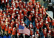 <p>In 1996, the Olympics were taking place in Atlanta, which meant that it was Team USA's time to shine. The men wore navy blazers and khaki pants with red neckties, while the women sported longline red blazers with floor-length navy skirts and navy neck scarves. No one was exempt from wearing the white cap with a red ribbon. </p>