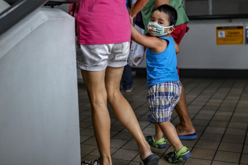 MANILA, PHILIPPINES - JANUARY 31: A child is seen wearing a face mask, as public fear over China's Wuhan Coronavirus grows, on January 31, 2020 in Manila, Philippines. The Philippine government has been heavily criticized after failing to immediately implement travel restrictions from China, the source of a deadly coronavirus that has now killed hundreds and infected thousands more. The World Health Organization (WHO) on Thursday declared the coronavirus a public health emergency of international concern. (Photo by Ezra Acayan/Getty Images)