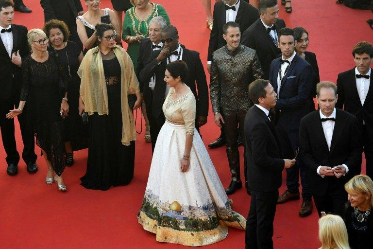 Israeli Culture Minister Miri Regev at the Cannes film festival's opening ceremony, wearing a dress featuring the Old City of Jerusalem