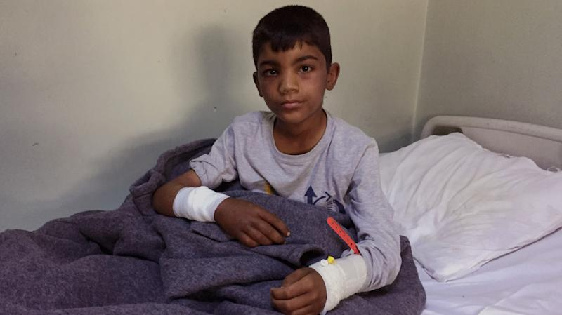 Ten-year old Thaier Nadm sits in his hospital bed in Erbil after a mortar attack near Mosul. (Photo: Ash Gallagher for Yahoo News)