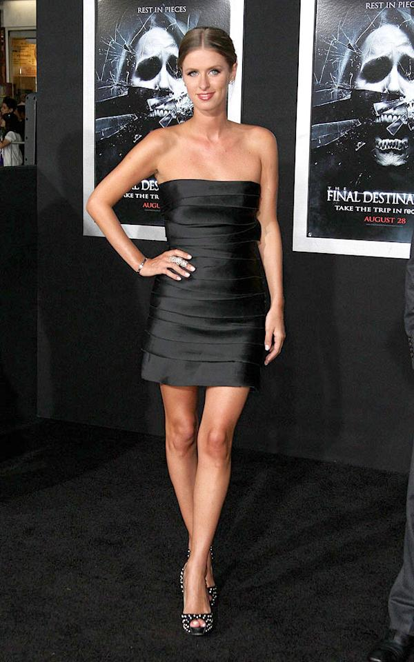 """Nicky Hilton struck a pose at the LA premiere of """"The Final Destination"""" in a black strapless Elise Overland mini and sexy studded Christian Louboutin """"Very Prive Peep-Toe Pumps."""" We're sure her big sister, Paris, would approve! Frederick M. Brown/<a href=""""http://www.gettyimages.com/"""" target=""""new"""">GettyImages.com</a> - August 31, 2009"""