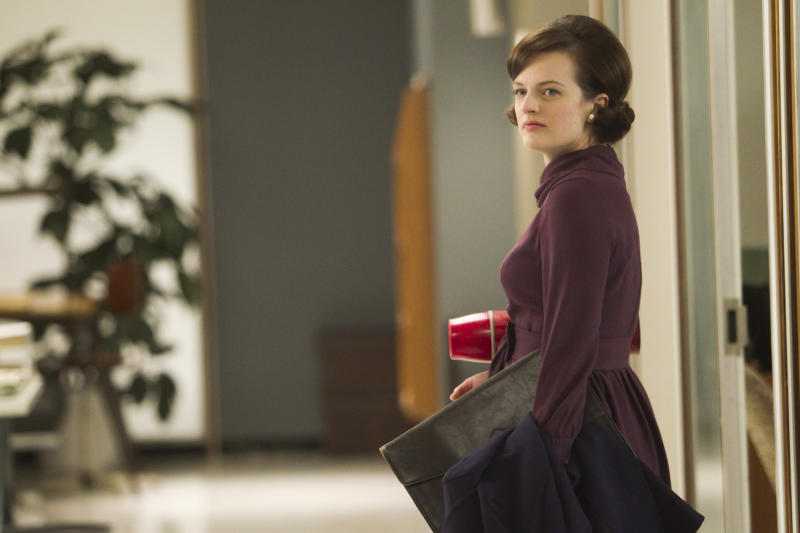 """In this publicity photo released by AMC, Elisabeth Moss as Peggy Olson is shown in Episode 11, Season 5, of """"Mad Men."""" Moss was nominated for an Emmy award on Thursday, July 19, 2012 for outstanding actress in a drama series for her role as Peggy Olson. The 64th annual Primetime Emmy Awards will be presented Sept. 23 at the Nokia Theatre in Los Angeles, hosted by Jimmy Kimmel and airing live on ABC. (AP Photo/AMC, Jordin Althaus)"""