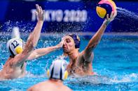 <p>TOKYO, JAPAN - JULY 25: Blake Edwards of Australia hitting the face of Aleksa Ukropina of Montenegro during the Tokyo 2020 Olympic Waterpolo Tournament Men match between Team Australia and Team Montenegro at Tatsumi Waterpolo Centre on July 25, 2021 in Tokyo, Japan (Photo by Marcel ter Bals/BSR Agency/Getty Images)</p>