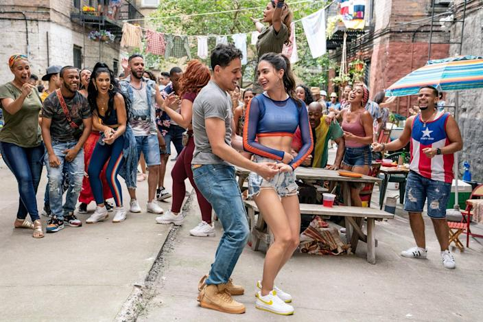 IN THE HEIGHTS, foreground from left: Anthony Ramos, Melissa Barrera, 2020.  ph: Macall Polay /  Warner Bros. / Courtesy Everett Collection